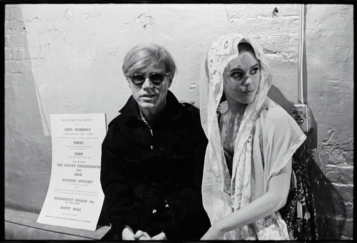 Andy Warhol with Edie Sedgwick (in veil)