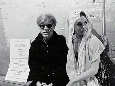 Andy Warhol with Edie Sedgwick (in veil), 1965